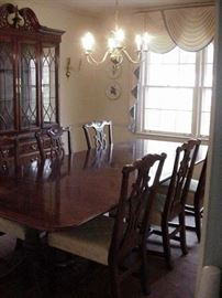 Beautiful mahogany table, banded border, leaves, and six Chippendale style chairs