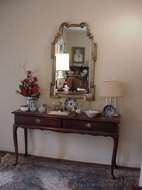 Mahogany hall console table with two drawers, and shaped mirror with gold leaf finish