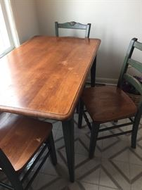 Solid kitchen table with four chairs
