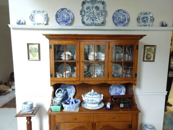 Vintage Ethan Allen cherry hutch, with collection of Blue Danube porcelain.