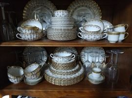 "60-piece set of Spode ""FLEUR DE LYS"" gold china - the owner is 93 and this was her wedding china set; from a ca. 1860 design."