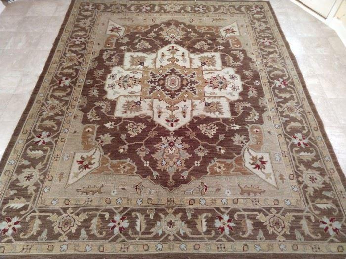 "Persian design Heriz rug, hand woven, 100% wool face, measures 8' 6""  x 11' 8""."