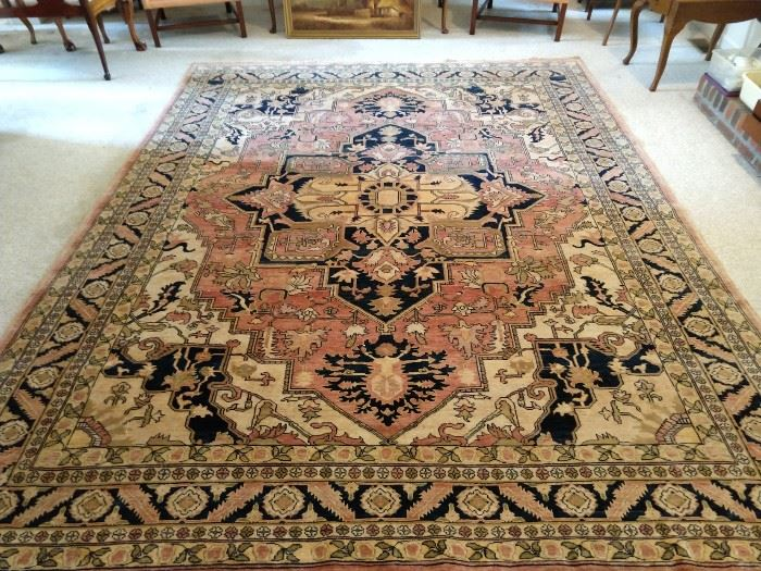 "Persian design Heriz rug, hand woven, 100% wool face, measures 9' 2""  x 11' 10""."