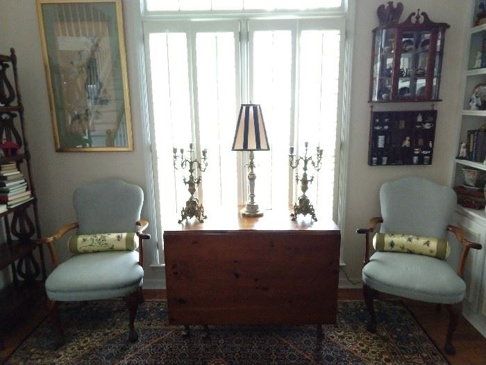 Vintage drop-leaf pine dining table, pair of upholstered wooden armchairs, pair of vintage brass 5-light candelabras, hanging shadow box collectibles, mirrored mahogany hanging curio cabinet and nicely framed/matted Asian artwork.