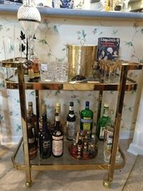 Vintage brass/glass tea cart, with all the requisite goodies that a bar cart should have.