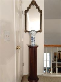 Fluted mahogany plant stand, with Asian blue/white porcelain vase and carved wood black/gold wall mirror.