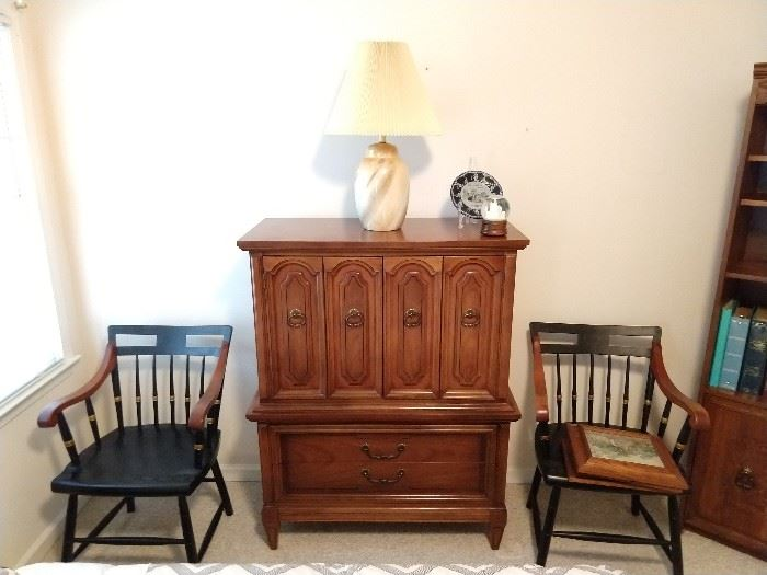 "This is part of the ""Dixie"" 5-piece bedroom suite, flanked by a pair of collegiate wooden armchairs."