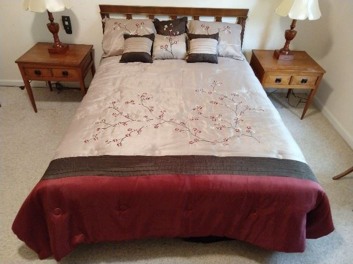 Queen size bed, with pair of handmade single drawer end tables and pair of wooden table lamps, made by the resident podiatrist.