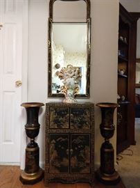 Hand painted Chinoiserie chest, with matching mirror, flanked by a pair of hand painted Theodore Alexander wooden urns,.