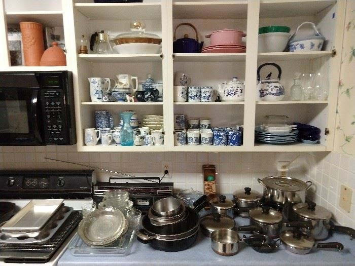 You'll find blue/white porcelain items throughout this house! Here's a few tucked away in the kitchen cabinets. Countertops filled with vintage, heavier Revere Ware pots, with lids, pie plates, muffin pans, cooling racks, etc.