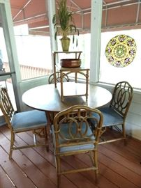 Vintage bamboo round table with four matching side chairs, topped by a vintage Heywood Wakefield bamboo end table.