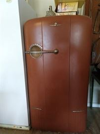 "Here it is ladies and a few choice men! It's the vintage 1940's Kelvinator ""Moist Master"" refrigerator freezer to rock your world!                                                                                 Yes, after visions of Chippendale Trail dancers swimming in your head, this Moist Master will tame your wanton desires. Instead of taking a cold shower, just stick your head in this thing to cool off."