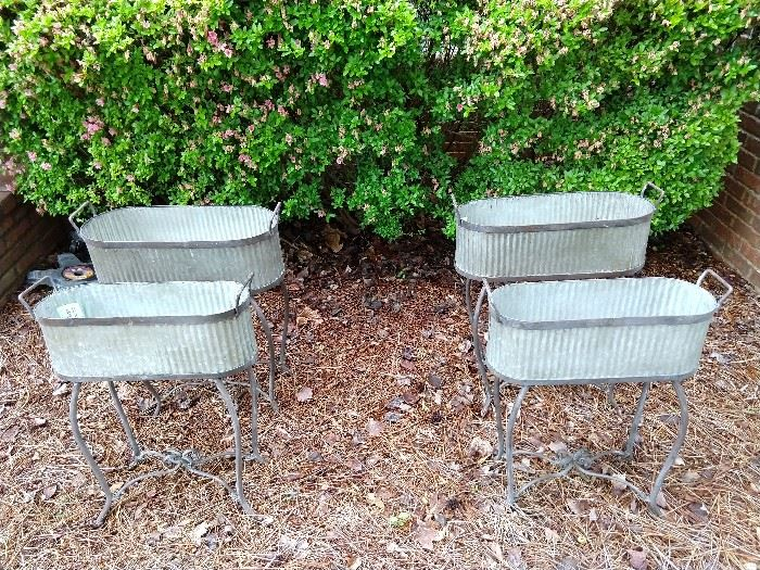 Two pair of graduated size galvanized tin flower planters.