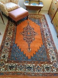 Persian design rug, hand woven, 100% wool face, measures 6' x 9'.