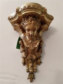 This is the real deal, gilt carved wood, not resin, made-in-China-yesterday schlock.