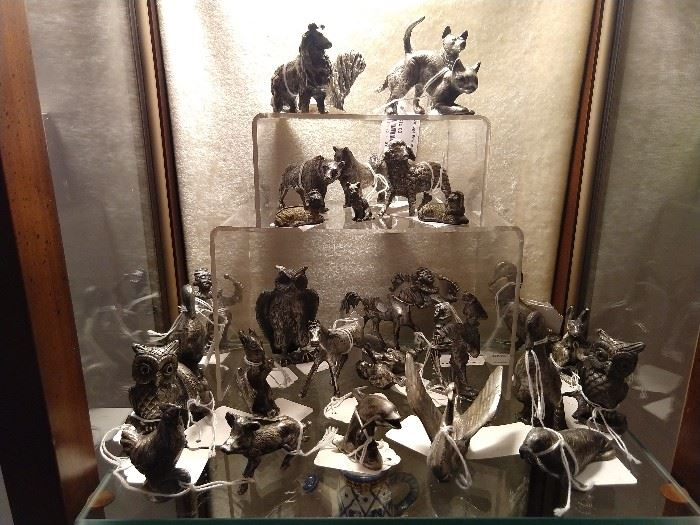 Miniature pewter collection of animals and figurines.