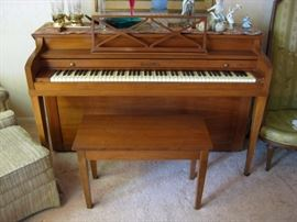Henry F. Miller Spinet upright acoustic piano with matching bench, medium brown walnut finish