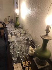 Pair of the green lamps and lots of stemware.