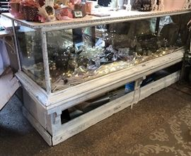 Antique sales counter. Broken glass on the right side.