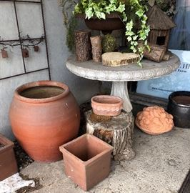 Outdoor pots and concrete table. As is.