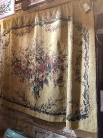 Tapestry with rod, finials and tassels.