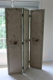 Three panel screen with floral decoration and border plus horn motif in center of each panel