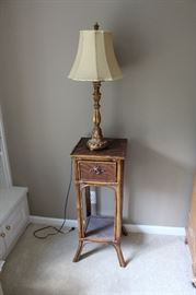 A close-up of the table, and a candlestick style lamp
