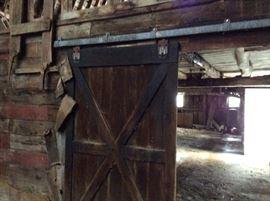 One of 3 barn doors on antique sliders