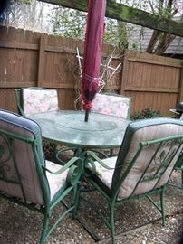 Patio  set, 6 chairs, table with lazy susan, umbrella and stand.  Some of the chairs need the seat straps replaced.  Very heavy set