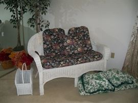 wicker settee with two sets of cushions, magazine basket, artificial tree