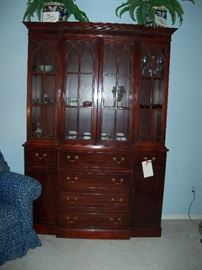mahogany breakfront (top drawer opens like a secretary.  Inside, misc glass and china