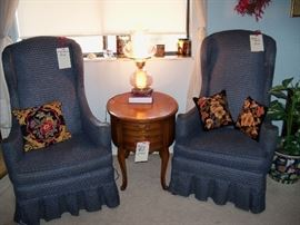 pair of highback chairs, needlepoint pillows and cute oval table with drawers.  Lamp and misc.