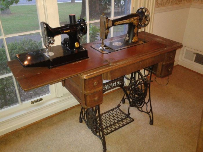 Antique Singer Sewing machine with iron stand.