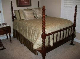 Antique Cherry Bedroom Suite with bedspread and some pillows