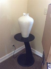 Black side table, white retro vase by Haeger pottery