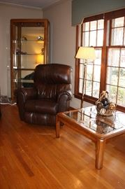 Leather rocker recliner/ lighted display cabinet