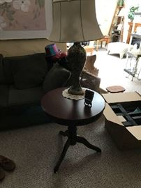 Two round end tables