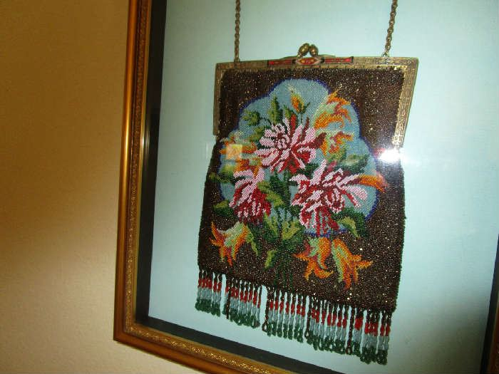 Framed antique beaded purse.