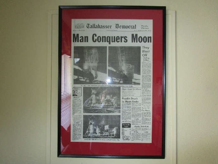 Framed Tallahassee Democrat newspaper of the Moon landing.