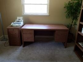 wooden desk and file cabinet