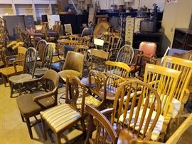 Every kinda chair you could thing of. Most are real wood.