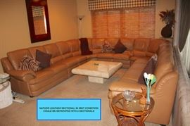 Natuzzi Leather Sectional in Mint Condition.  Can be separated into 2 Sectionals, Square  Marble Pedestal  Coffee Table, Mirror, Side Table and Decorative