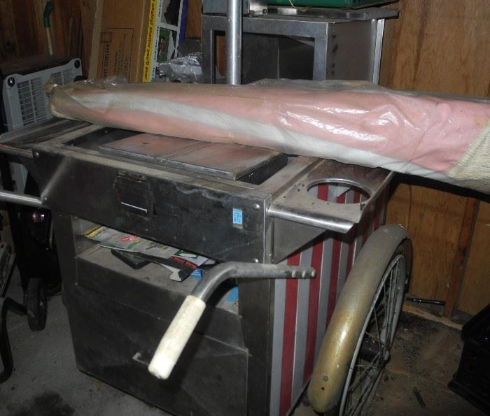 Check out this great, vintage, authentic hot dog rolling cart with original umbrella!  Tail gating anyone?
