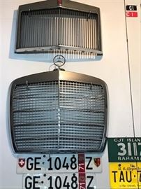 Vintage Lincoln Continental and Mercedes Benz grills,  Swiss license plates, Bahamas and U.S. Virgin Island plates.