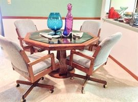 Very Nice Octagon Wood/Glass Dining Table with 4 Rolling Chairs in Excellent Condition.