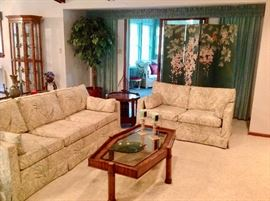 Ethan Allen Sofa & Loveseat.  Both in excellent condition.  Burl Wood/Glass Coffee Table with 2 matching end tables and a Sofa Table
