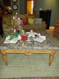 Carved, marble topped stately coffee table from Good's Furniture.