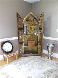 Detailed burled cabinet, contemporary area rug, magnificent urn and home accents.