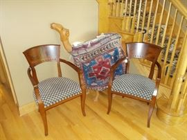 Pair of wood upholstered chairs flanking a camel prop, perfect for nativity scenes. Carpet bag sold separately.