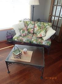 IRON SET WITH CARVED DETAILS AND FLORAL CUSHIONS - 2 SIDE CHAIRS - GLASS END TABLE - 2 SEAT SOFA - GLASS COFFEE TABLE - TABLE AND CHAIRS